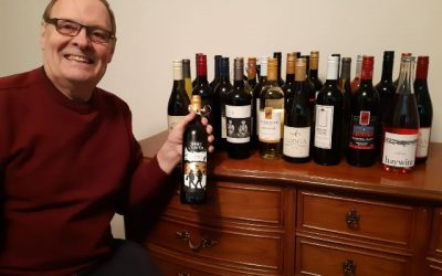 Who won the 25 bottles of wine at OLWQS fundraiser?
